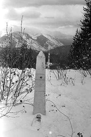 A Border Monument and the Border strip looking east from Boundary Ridge
