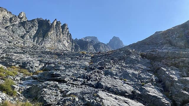 While ascending Leroy basin and following the massive cirque of Seven Fingered Jack, Fernow was not visible and we had difficulty visually identifying the route. As with many peaks, from a distance, Fernow appeared unclimbable. However once at the basin, it looked more reasonable. The route took us up some slabby ledges and follows the outlet flow of the upper snowfield.