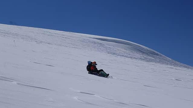 Jamie sledding down above camp 2